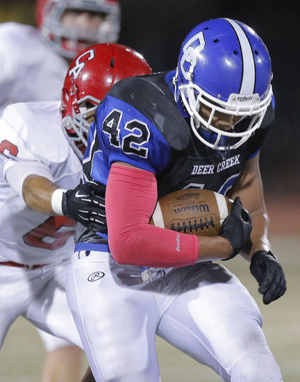 Deer Creek's Alec James rushes as Carl Albert's Isaiah Shawver tackles him  during the high school football game between Deer Creek and Carl Albert at Deer Creek High School, Friday, Sept. 21, 2012.  Photo by Sarah Phipps, The Oklahoman