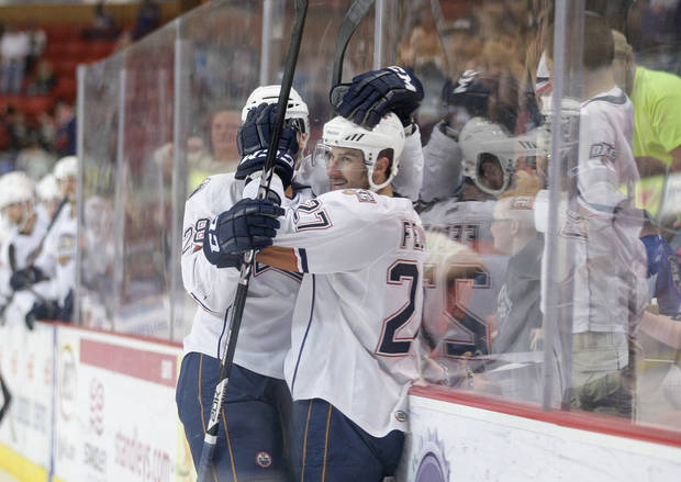 Oklahoma City�s Martin Marincin, left, and Taylor Fedun celebrate after Fedun scored in the second period of Thursday�s game against Texas.  PHOTO BY STEVEN CHRISTY, OKLAHOMA CITY BARONS