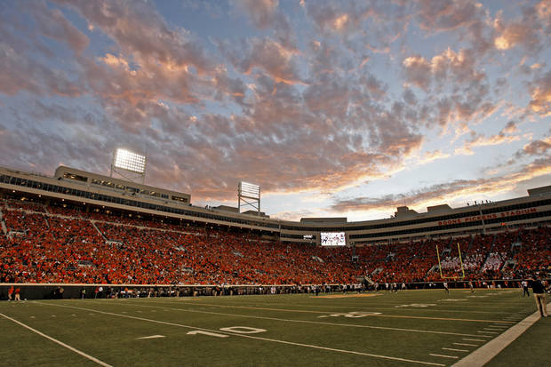 The sun sets over Boone Pickens Stadium during a college football game between Oklahoma State University (OSU) and West Virginia University at Boone Pickens Stadium in Stillwater, Okla., Saturday, Nov. 10, 2012. Oklahoma State won 55-34. Photo by Bryan Terry, The Oklahoman