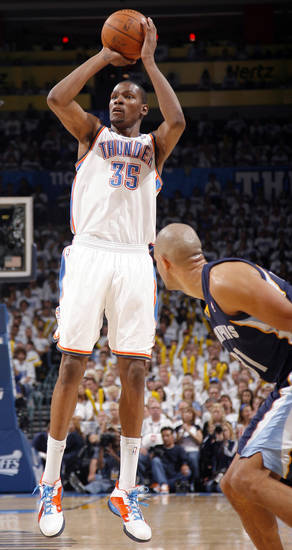 Oklahoma City's Kevin Durant (35) shoots as Shane Battier (31) of Memphis   watches during game five of the Western Conference semifinals between the Memphis Grizzlies and the Oklahoma City Thunder in the NBA basketball playoffs at Oklahoma City Arena in Oklahoma City, Wednesday, May 11, 2011. Photo by Sarah Phipps, The Oklahoman