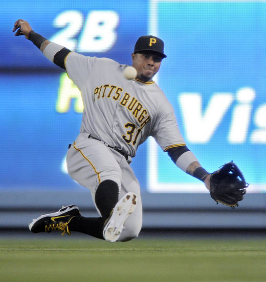 Pittsburgh Pirates right fielder Jose Tabata can't make the catch on base hit by Mark Ellis during the first inning of a baseball game, Thursday, April 12, 2012, in Los Angeles. (AP Photo/Mark J. Terrill)