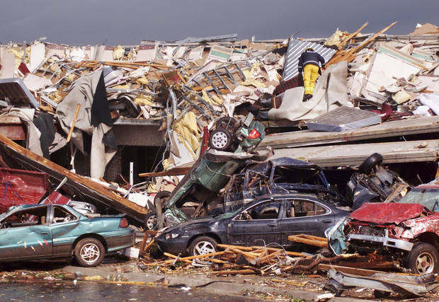 MAY 3, 1999 TORNADO: Tornado damage: Emergency workers look through the remains of the Hampton Inn at I-40 and Sooner Rd. in Midwest City.