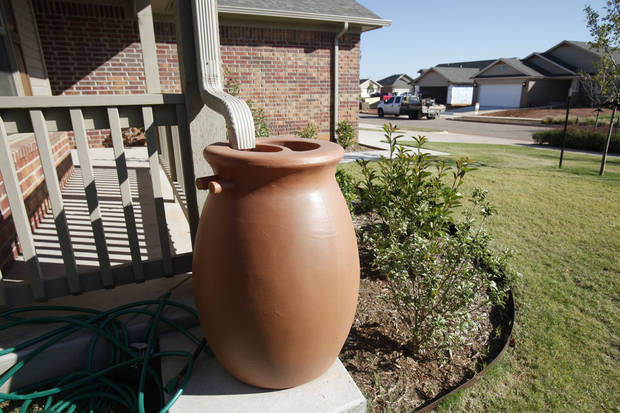 Attractive cisterns are a part of a natural system for runoff water filtration in the Trail Woods addition in Norman. <strong>PAUL HELLSTERN - The Oklahoman</strong>
