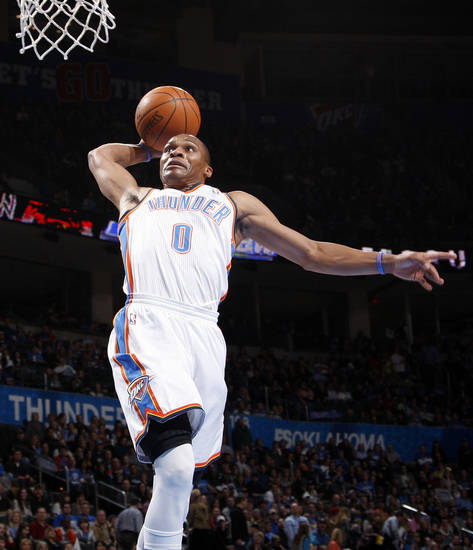 Oklahoma City's Russell Westbrook (0) slam dunks the ball in the first quarter during the NBA basketball game between the Oklahoma City Thunder and the Houston Rockets at Chesapeake Energy Arena in Oklahoma City, Friday, Jan. 6, 2012. Photo by Nate Billings, The Oklahoman