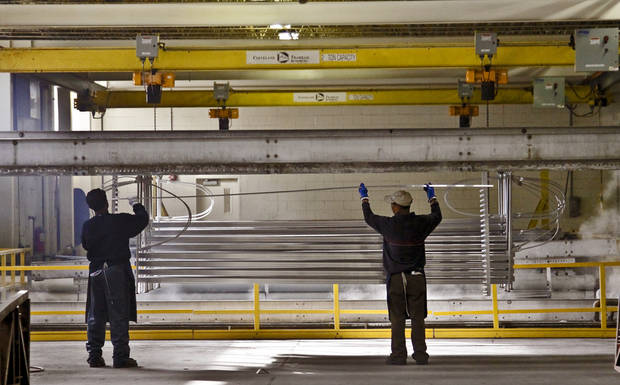 Crews work in the aluminum anodizing area at the MD Building Products plant on Wednesday, Jan. 2, 2013, in Oklahoma City, Okla. Photo by Chris Landsberger, The Oklahoman