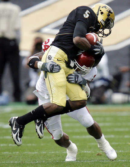 Colorado's Kendrick Celestine (5) makes a catch for a first down as Oklahoma's Marcus Walker (24) defends late in the fourth quarter of the college football game between the University of Oklahoma Sooners (OU) and the University of Colorado Buffaloes (CU) at Folsom Field in Boulder, Co., on Saturday, Sept. 28, 2007. Colorado won, 27-24. By NATE BILLINGS, The Oklahoman