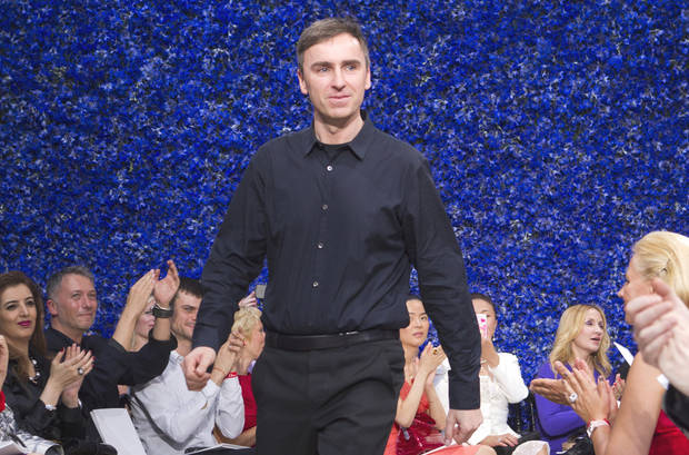 Belgian Fashion designer Ralf Simons for house's Dior, appears at the end of her Women's Fall Winter 2013 haute couture fashion collection, for fashion house in Paris, France, Monday, July 2, 2012. (AP Photo/Jacques Brinon)