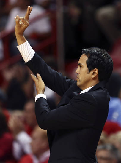 Miami Heat head coach coach Erik Spoelstra signals during the first half of an NBA basketball game against the Oklahoma City Thunder, Tuesday, Dec. 25, 2012, in Miami. (AP Photo/J Pat Carter)