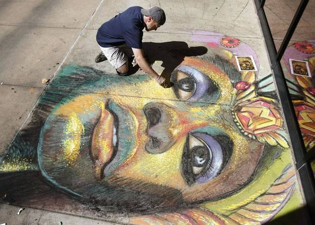 Chalk artist Bobby Marsee creates a work of art, as Rose State College hosts a cultural fair as part of the 23rd annual Global Oklahoma festival at the Rose State College campus in Midwest City, OK, Saturday, Oct. 1, 2011. By Paul Hellstern, The Oklahoman ORG XMIT: KOD