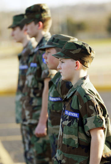 Cadets, including Brendan Schulte, foreground, stand in formation at a squadron meeting in Edmond.