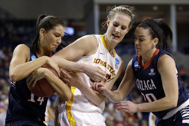 Gonzaga's Sunny Greinacher, left, grabs the ball away from Iowa State's Anna Prins as Gonzaga's Meghan Winters, right, watches in the first half during a first-round game in the women's NCAA college basketball tournament in Spokane, Wash., Saturday, March 23, 2013. (AP Photo/Elaine Thompson)