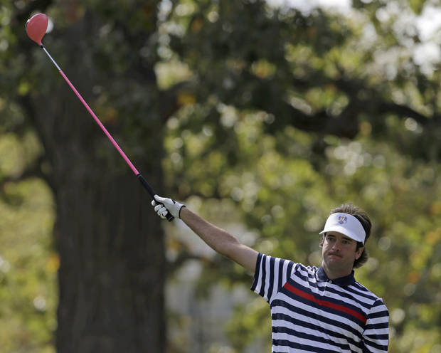 USA's Bubba Watson reacts to his tee shot on the fourth hole during a singles match at the Ryder Cup PGA golf tournament Sunday, Sept. 30, 2012, at the Medinah Country Club in Medinah, Ill. (AP Photo/David J. Phillip)  ORG XMIT: PGA118