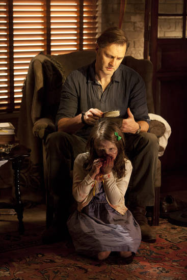 "This undated image released by AMC shows David Morrisey as The Governor brushing the hair of Kylie Szymanski as Penny in a scene from the third season of ""The Walking Dead."" The popular zombie series returns for another eight episodes Sunday at 9 p.m. EST.  (AP Photo/AMC, Russell Kaye)"