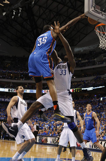 Oklahoma City's Kevin Durant (35) goes up for a dunk over Brendan Haywood (33) of Dallas during game 2 of the Western Conference Finals in the NBA basketball playoffs between the Dallas Mavericks and the Oklahoma City Thunder at American Airlines Center in Dallas, Thursday, May 19, 2011. Photo by Bryan Terry, The Oklahoman
