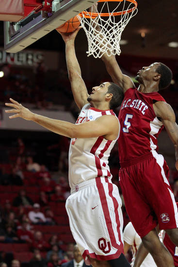 Oklahoma Sooners&#039; C.J. Washington (5) shoots guarded by South Carolina State Bulldogs&#039; Omar Sanders (5) as the University of Oklahoma (OU) Sooners play the South Carolina State Bulldogs in men&#039;s college basketball at the Lloyd Noble Center on Wednesday, Dec. 21, 2011, in Norman, Okla.   Photo by Steve Sisney, The Oklahoman