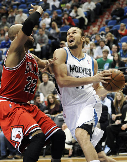 Minnesota Timberwolves' Lou Amundson, right, eyes the basket as Chicago Bulls' Taj Gibson defends during the first half of an NBA preseason basketball game, Saturday, Oct. 13, 2012, in Minneapolis. (AP Photo/Jim Mone)