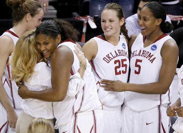 OU's Courtney Paris higs coach Sherri Coale as Whitney Hand, center, and Ashley Paris celebrate in the final moments of their win in the NCAA women's basketball tournament game between Oklahoma and Pittsburgh at the Ford Center in Oklahoma City, Sunday, March 29, 2009.  PHOTO BY BRYAN TERRY, THE OKLAHOMAN
