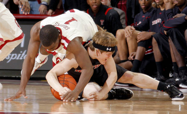 Oklahoma's Sam Grooms (1) and Texas Tech's Luke Adams (13) fight for a loose ball during the men's college basketball game between the University of Oklahoma  and Texas Tech University of at the Lloyd Nobel Center in Norman, Okla., Tuesday, Jan. 17, 2012. Photo by Sarah Phipps, The Oklahoman