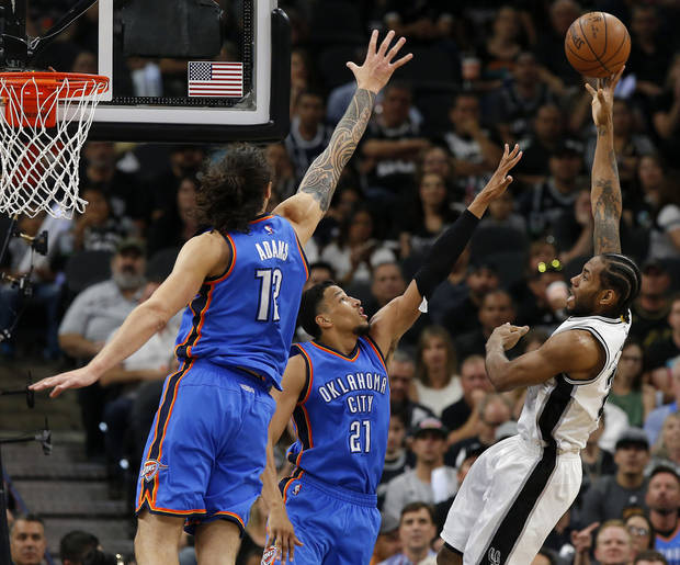 San Antonio's Kawhi Leonard (2) shoots over Oklahoma City's Steven Adams (12) and Andre Roberson (21) during Game 5 of the second-round series between the Oklahoma City Thunder and the San Antonio Spurs in the NBA playoffs at the AT&T Center in San Antonio, Tuesday, May 10, 2016. Oklahoma City won 95-91. Photo by Bryan Terry, The Oklahoman