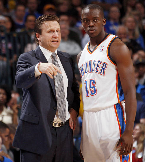 Oklahoma City head coach Scott Brooks talks to Reggie Jackson (15) during the NBA basketball game between the Oklahoma City Thunder and the Dallas Mavericks at Chesapeake Energy Arena in Oklahoma City, Monday, March 5, 2012. The Thunder won, 95-91. Photo by Nate Billings, The Oklahoman