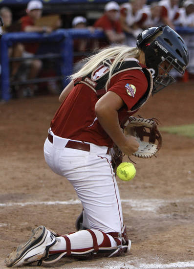 Oklahoma catcher, Jessica Shults (18), during a Women's College World Series game between OU and Alabama at ASA Hall of Fame Stadium in Oklahoma City, Monday, June 4, 2012.  Photo by Garett Fisbeck, The Oklahoman