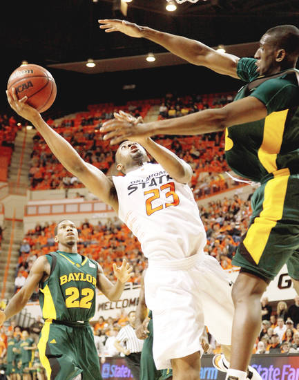 OSU's James Anderson goes to the basket between Baylor's A.J. Walton, left, and Ekpe Udoh during the Cowboys' 82-75 win Saturday.  PHOTO BY BRYAN TERRY, THE OKLAHOMAN