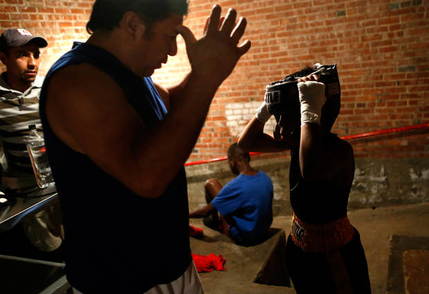 Chris Barba, 9, of Edmond, talks with his coach Fernando Mijares before his first fight at The Underground Arena in Oklahoma City, Saturday, June 15, 2013. Photo by Bryan Terry, The Oklahoman