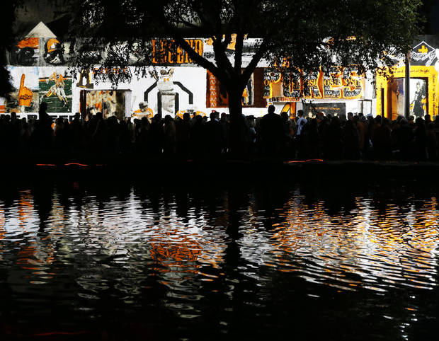 OSU's Theta Pond reflects the Lamda Chi Alpha/Alpha Delta Pi house decoration during Walkaround at Oklahoma State University's homecoming in Stillwater, Okla., Friday, Oct. 19, 2012. Photo by Nate Billings, The Oklahoman