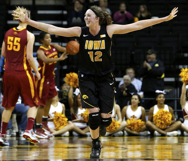 Iowa center Morgan Johnson (12) celebrates after a basket against Iowa State during the second half of their NCAA college basketball game, Thursday, Dec. 6, 2012, in Iowa City, Iowa. Iowa won 50-42. (AP Photo/Cedar Rapids Gazette, Brian Ray)  MAGS OUT