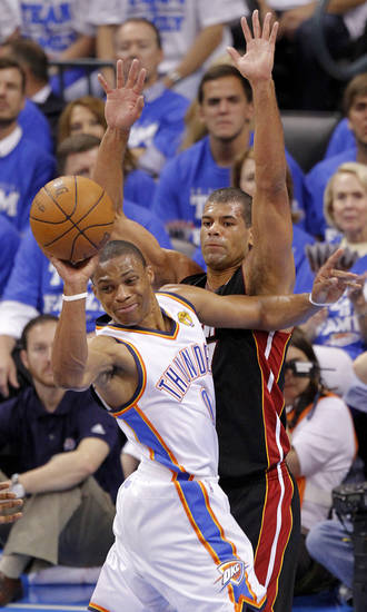 Oklahoma City's Russell Westbrook (0) looks to pass as Miami's Shane Battier (31) defends during Game 2 of the NBA Finals between the Oklahoma City Thunder and the Miami Heat at Chesapeake Energy Arena in Oklahoma City, Thursday, June 14, 2012. Photo by Chris Landsberger, The Oklahoman