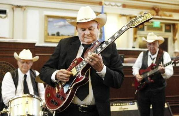 Joe Settlemire, center, Oklahoma City, playing the guitar on the floor of the House of Representatives during Bob Wills Day at the state Capitol in Oklahoma City Wednesday, May 1, 2013. Photo by Paul B. Southerland, The Oklahoman