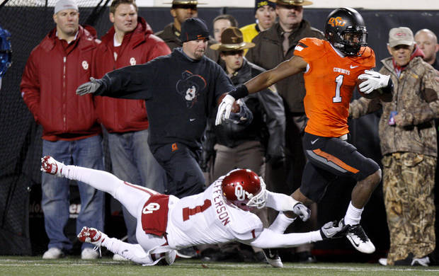 Oklahoma State's Joseph Randle (1) runs past Oklahoma's Tony Jefferson (1)during the Bedlam college football game between the Oklahoma State University Cowboys (OSU) and the University of Oklahoma Sooners (OU) at Boone Pickens Stadium in Stillwater, Okla., Saturday, Dec. 3, 2011. Photo by Bryan Terry, The Oklahoman