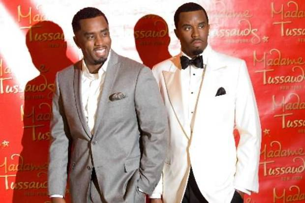 Diddy stands next to his wax figure at Madam Tussauds in New York. (AP Photo/Charles Sykes)