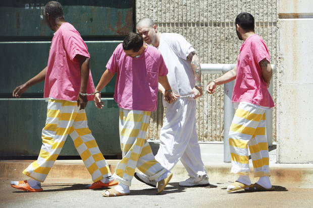Cleveland County inmates wear jail-issue uniforms. PHOTO BY STEVE SISNEY, THE OKLAHOMAN