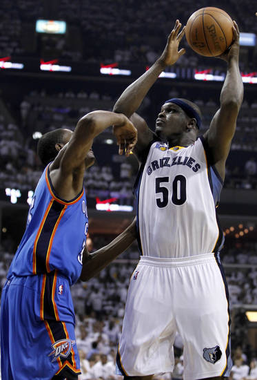 Memphis Grizzlies forward Zach Randolph (50) shoots against Oklahoma City Thunder forward Kevin Durant during the first half of Game 4 of a second-round NBA basketball playoff series on Monday, May 9, 2011, in Memphis, Tenn. (AP Photo/Wade Payne)