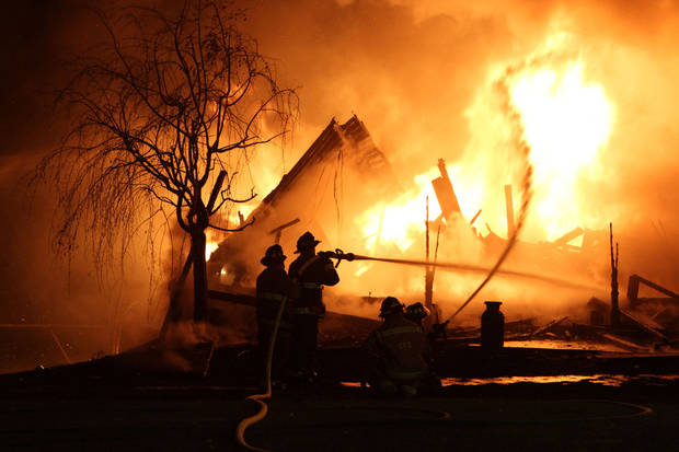 Firefighters battle an early morning blaze Tuesday May 1, 2012, that killed a veteran police captain, his wife and two teenage daughters when fire that swept through their home in Carmel, N.Y. Larchmont, N.Y. police identified the dead as Thomas Sullivan of the Larchmont police, his wife, Donna, and their two daughters. A son escaped from the burning Carmel home in Putnam County, about 60 miles north of New York City. (AP Photo/The Journal News, Frank Becerra Jr) NYC METRO OUT; TV OUT; MAGS OUT; NO SALES