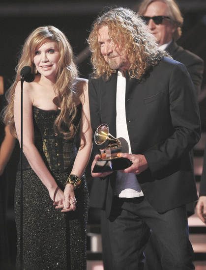 Alison Krauss, left, and Robert Plant accept the award for album of the year Sunday at the 51st Annual Grammy Awards in Los Angeles. The pair ended the night with five awards. AP PHOTO
