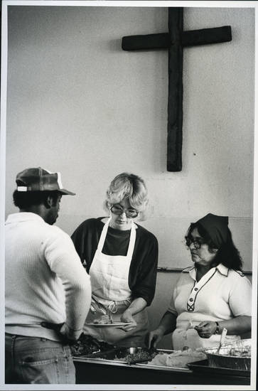 Volunteers Betty Eaton, center, and Rosa Garcia serve food on Thanksgiving Day 1983 at the Jesus House. <strong>JIM BECKEL - STAFF</strong>