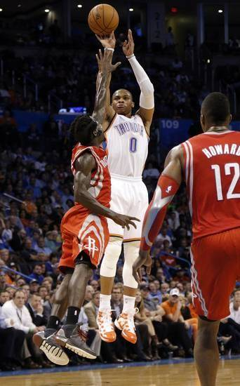 Oklahoma City's Russell Westbrook (0) shoots over Houston's Patrick Beverley (2) during the NBA game between the Oklahoma City Thunder and Houston Rockets at the Chesapeake Energy Arena in Oklahoma City, Okla., Tuesday, March 11, 2014. Photo by Sarah Phipps, The Oklahoma