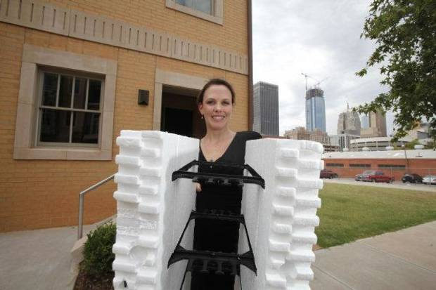 Sarah Bytyqi displays a sample of energy-efficient Insulated Concrete Forms used in the Brownstones at Maywood Park near downtown Oklahoma City. Photo by Steve Gooch, The Oklahoman <strong>Steve Gooch</strong>