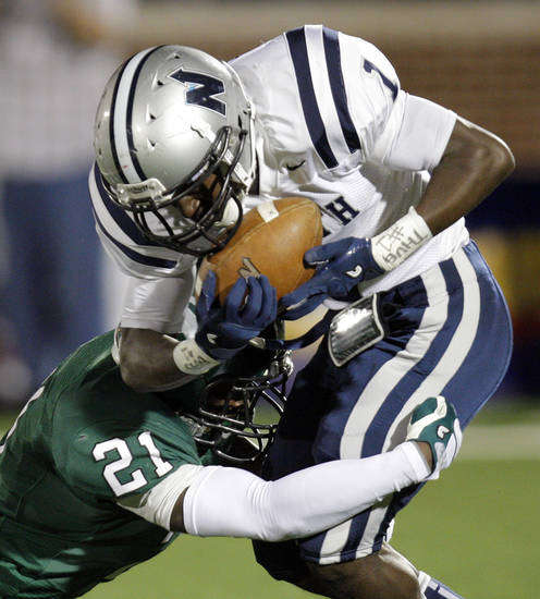 Edmond Santa Fe's Ryan Frazier (21) tackles Jarion Tudman (1) of Edmond North during a high school football game between Edmond Santa Fe and Edmond North at Wantland Stadium in Edmond, Okla., Friday, Oct. 28, 2011. Photo by Nate Billings, The Oklahoman