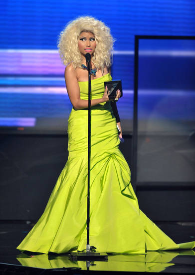 Nicki Minaj accepts the award for favorite album - rap/hip-hop �Pink Friday: Roman Reloaded� at the 40th Annual American Music Awards on Sunday, Nov. 18, 2012, in Los Angeles. (Photo by John Shearer/Invision/AP)