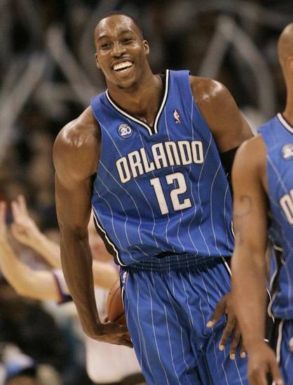 Orlando Magic center Dwight Howard smiles after being called for a foul in the third quarter of an NBA basketball game against the Oklahonma City Thunder in Oklahoma City, Wednesday, Nov. 12, 2008. Howard recorded his first career triple double as Orlando defeated Oklahoma City 109-92. (AP Photo/Sue Ogrocki) ORG XMIT: OKSO105