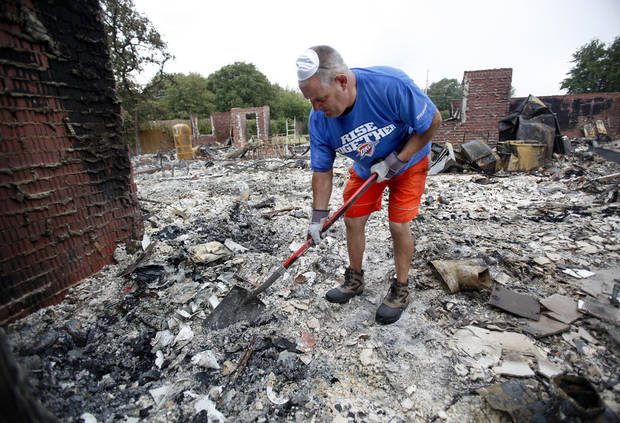 George Reich tries to salvage items after his home on Blackjack Lane was destroyed by wildfire in Edmond, Okla.,  Sunday, Aug. 7, 2011. Photo by Sarah Phipps, The Oklahoman