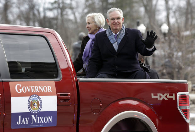 Missouri Gov. Jay Nixon, right, and first lady Georganne Nixon ride in the back of a pickup truck during a inauguration day parade Monday, Jan. 14, 2013, in Jefferson City, Mo. Nixon is scheduled to be sworn in for a second term at noon. (AP Photo/Jeff Roberson)