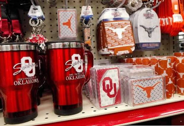 Items with the University of Oklahoma logo sit next to items bearing the Longhorn emblem from the University of Texas at Love's Travel Plaza on I-35 in Pauls Valley Tuesday, Dec. 20, 2011. Photo by Jim Beckel