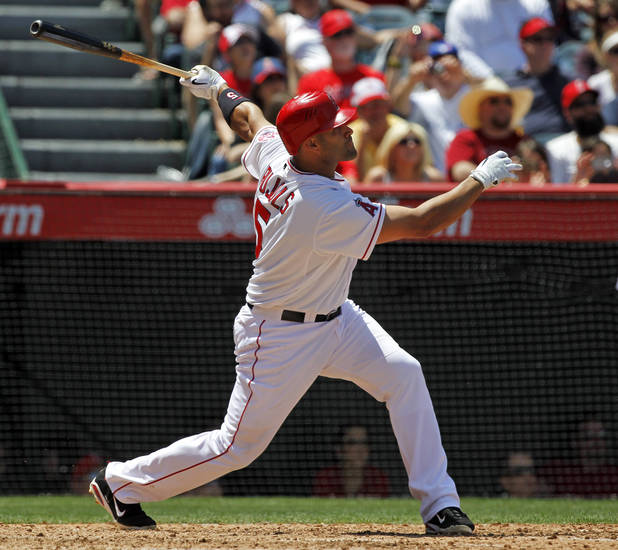 Los Angeles Angels' Albert Pujols watches his two-run home run against the Toronto Blue Jays during the fifth inning of a baseball game in Anaheim, Calif., Sunday, May 6, 2012. This was Pujols' first home run of the season. (AP Photo/Chris Carlson)
