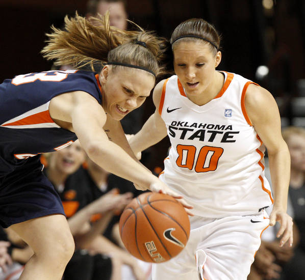 Pepperdine's Katie Menton (23) goes for the ball beside OSU's Lakyn Garrison (00) during a first-round NIT women's college basketball game between Oklahoma State University (OSU) and Pepperdine at Gallagher-Iba Arena in Stillwater, Okla., Wednesday, March 16, 2011. Photo by Bryan Terry, The Oklahoman