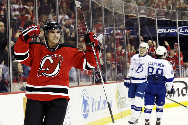 New Jersey Devils' Adam Henrique reacts after scoring a goal against the Tampa Bay Lightning during the second period of an NHL hockey game, Thursday, Feb. 7, 2013, in Newark, N.J. (AP Photo/Julio Cortez)