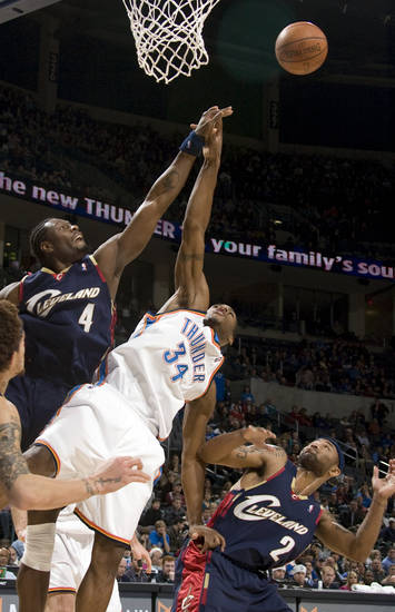 Oklahoma City's Desmond Mason (34) fights for a rebound with Cleveland's Ben Wallace (4) and Mo Williams (2) during the NBA game between the Oklahoma City Thunder and Cleveland Cavaliers, Sunday, Dec. 21, 2008, at the Ford Center in Oklahoma City. PHOTO BY SARAH PHIPPS, THE OKLAHOMAN